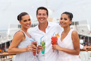 group of friends drinking cocktails on cruise ship
